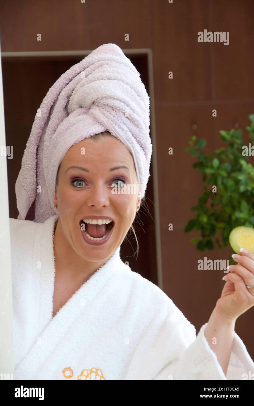 Junge, vitale Frau im Bademantel - young, vital woman in bathrobe - Stock Image