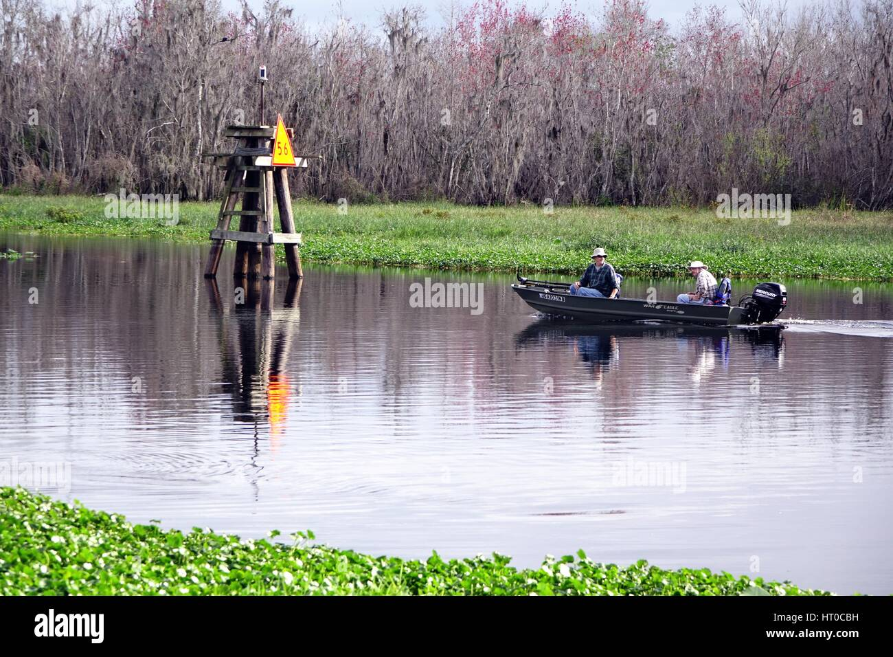 Fishermen on the St. Johns River in an aluminum boat, War Eagle. - Stock Image