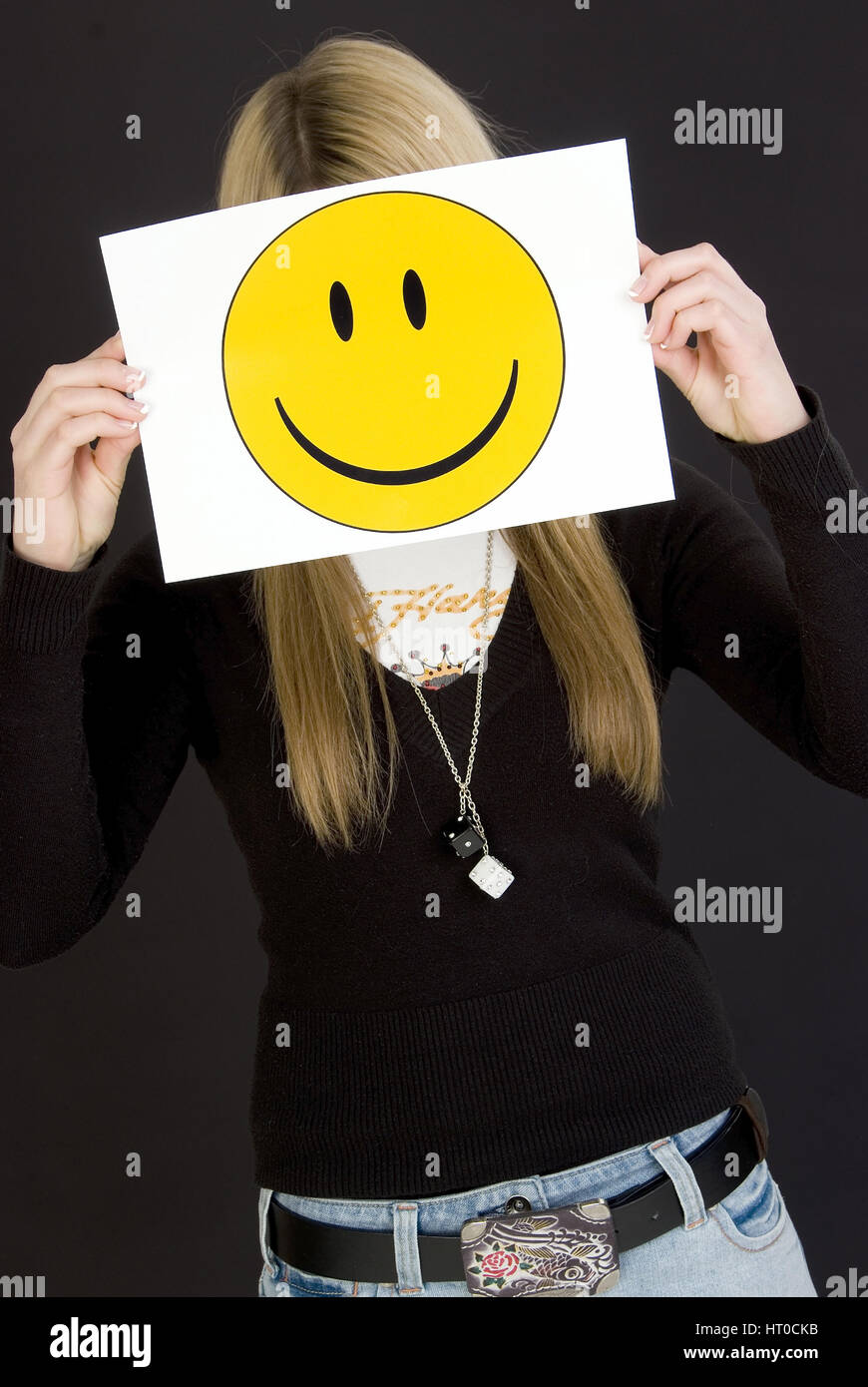 M‰dchen mit lachendem Smileygesicht - girl with laughing smiley face - Stock Image