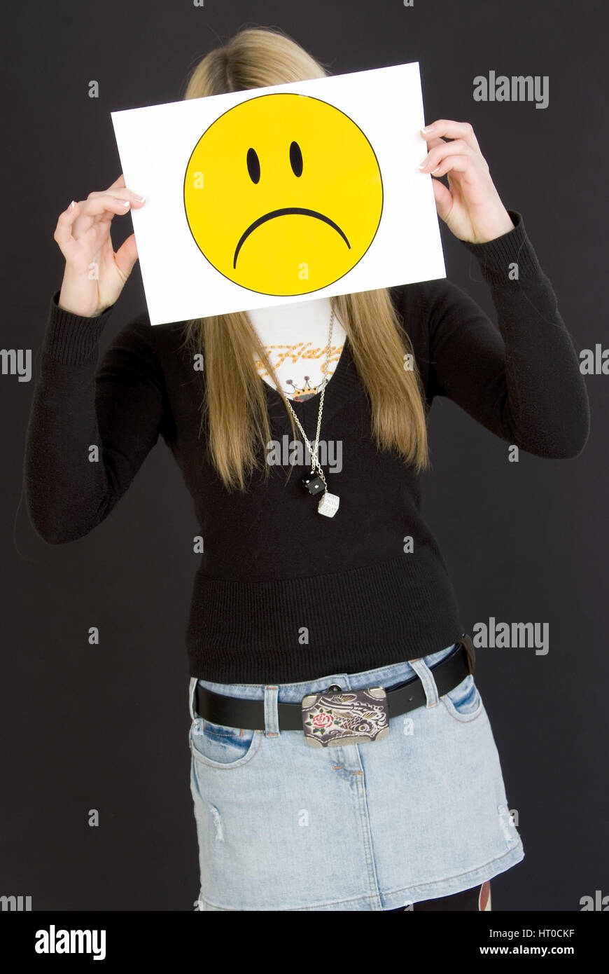 M‰dchen mit traurigem Smileygesicht - girl with sad smiley face - Stock Image