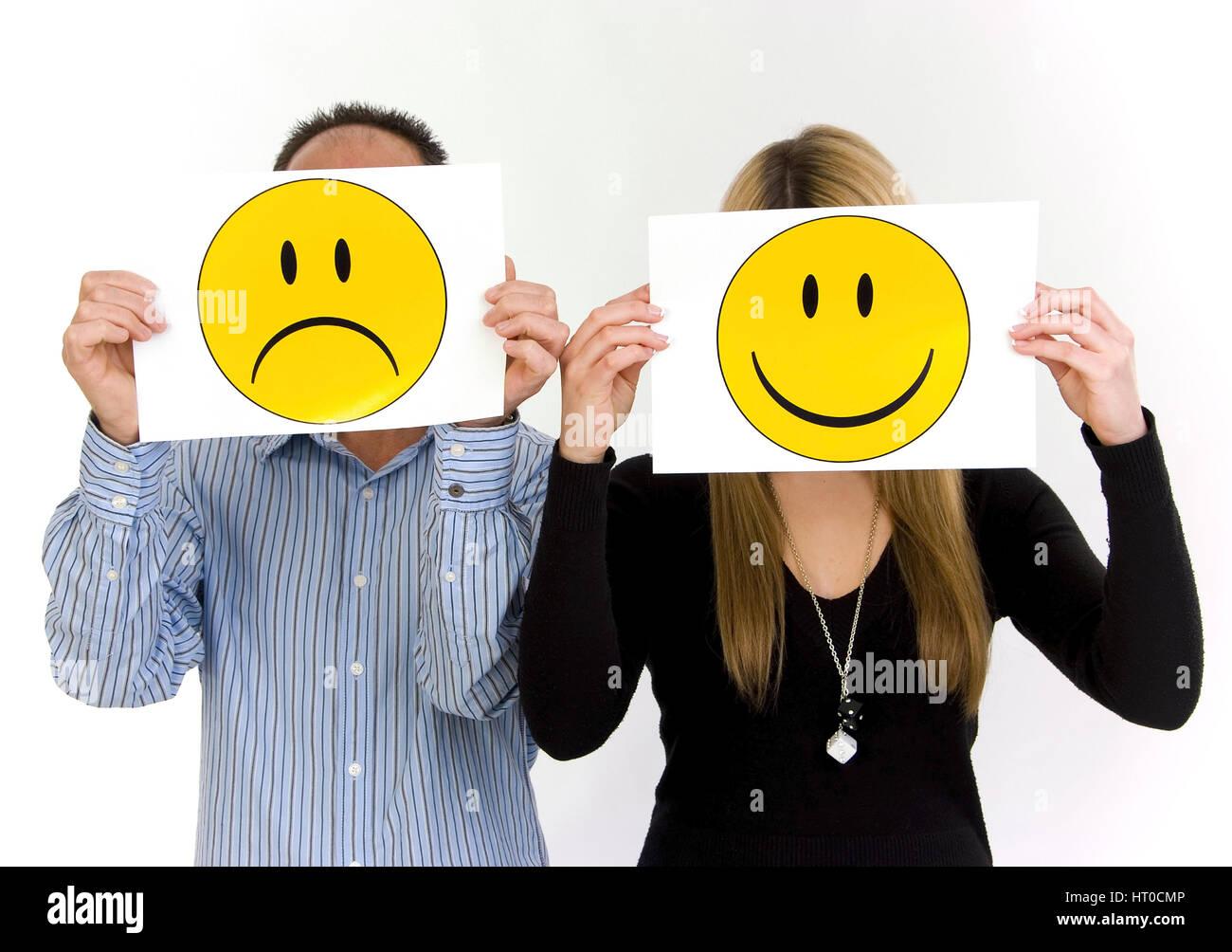 trauriger Mann, lachende Frau, Symbolbild unausgeglichene Partnerschaft - sad man, lucky woman - Stock Image