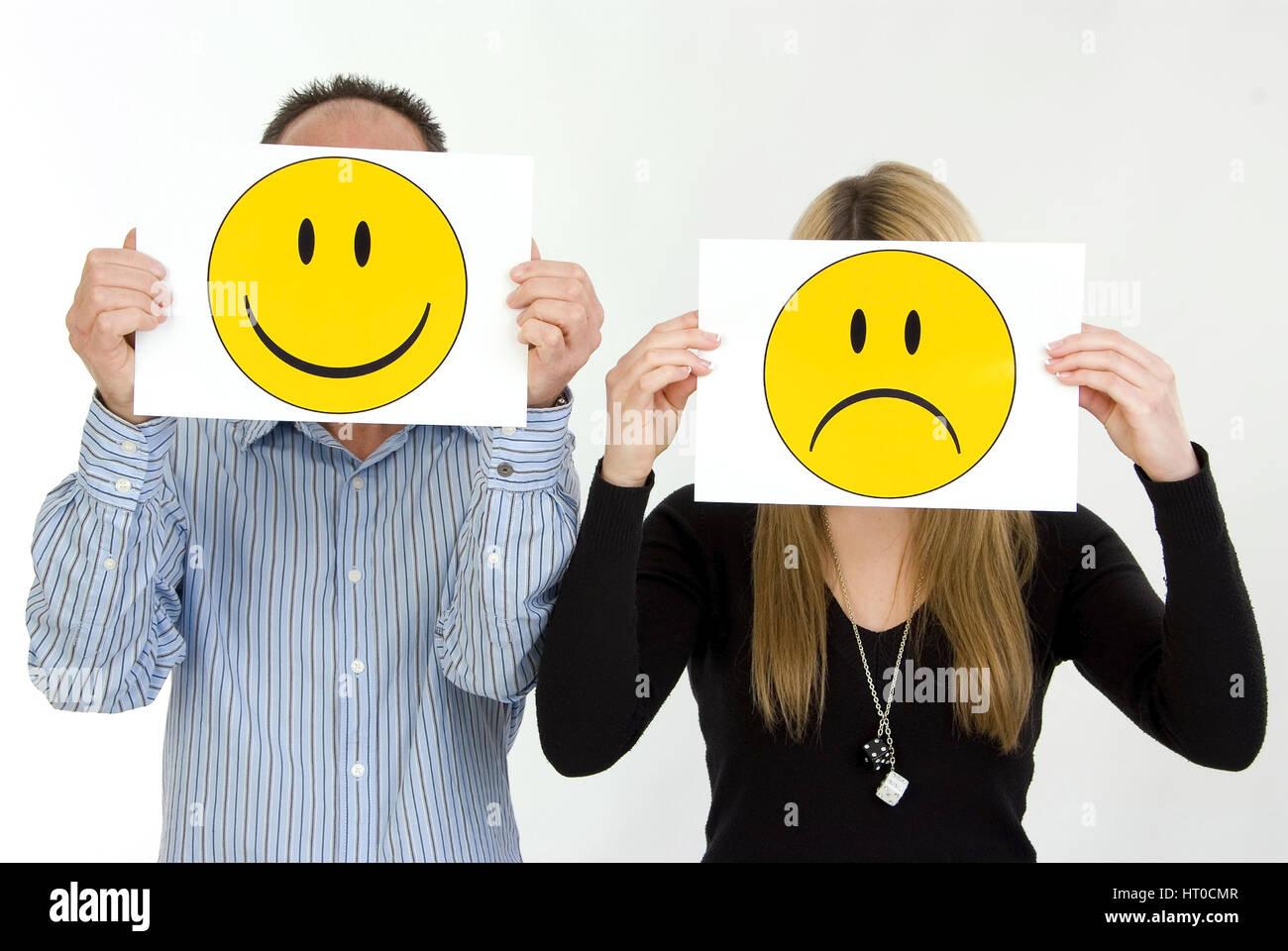 lachender Mann, traurige Frau, Symbolbild unausgeglichene Partnerschaft - sad woman, lucky man - Stock Image