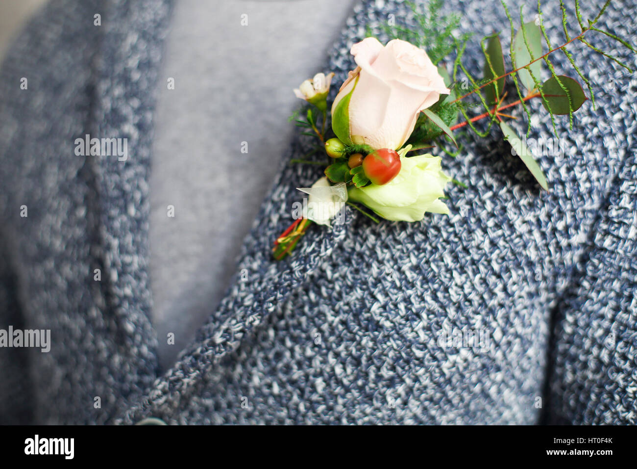 Gentle groom boutonniere with roses and beads. Close up Stock Photo