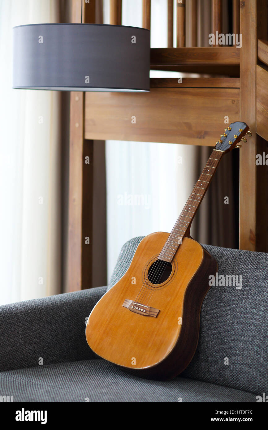 Cozy living room with guitar on the sofa Stock Photo