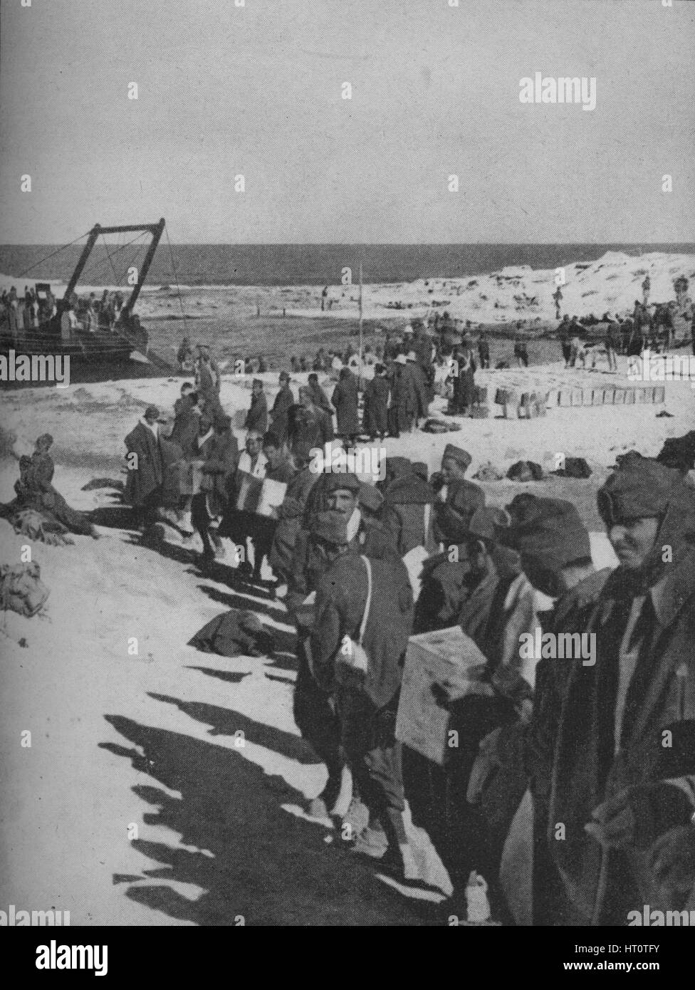 Italian prisoners captured by the British assisting in the loading of a store ship, 1941. Artist: Unknown. - Stock Image