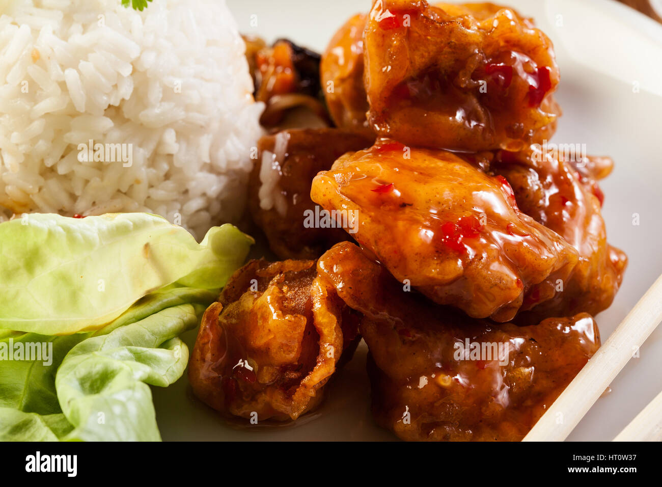 Fried chicken pieces in batter with sweet and sour sauce - Stock Image
