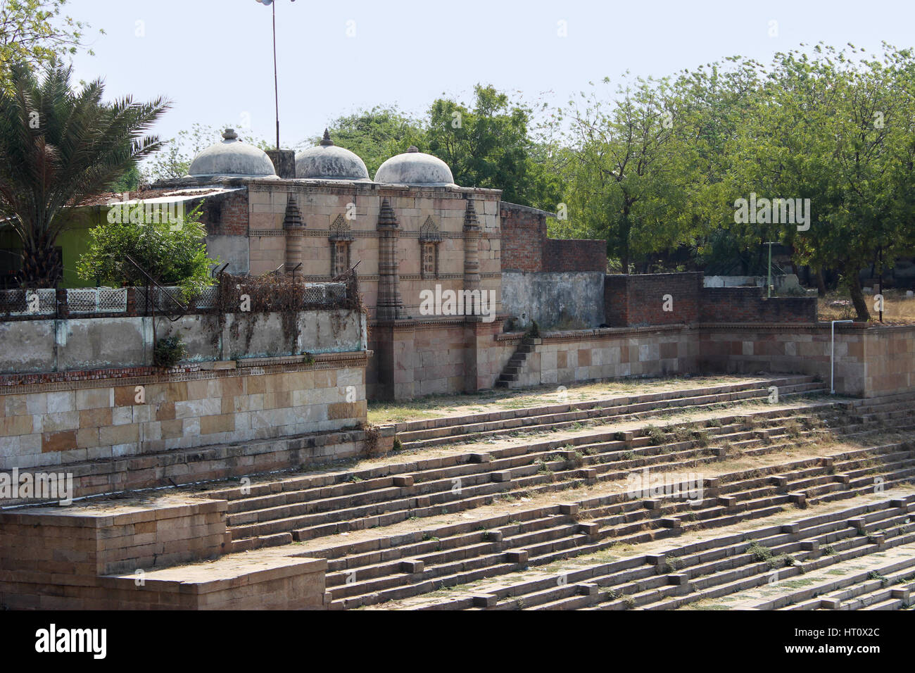 Building around a stepped tank. Sarkhej Roza, Ahmedabad, Gujarat India - Stock Image