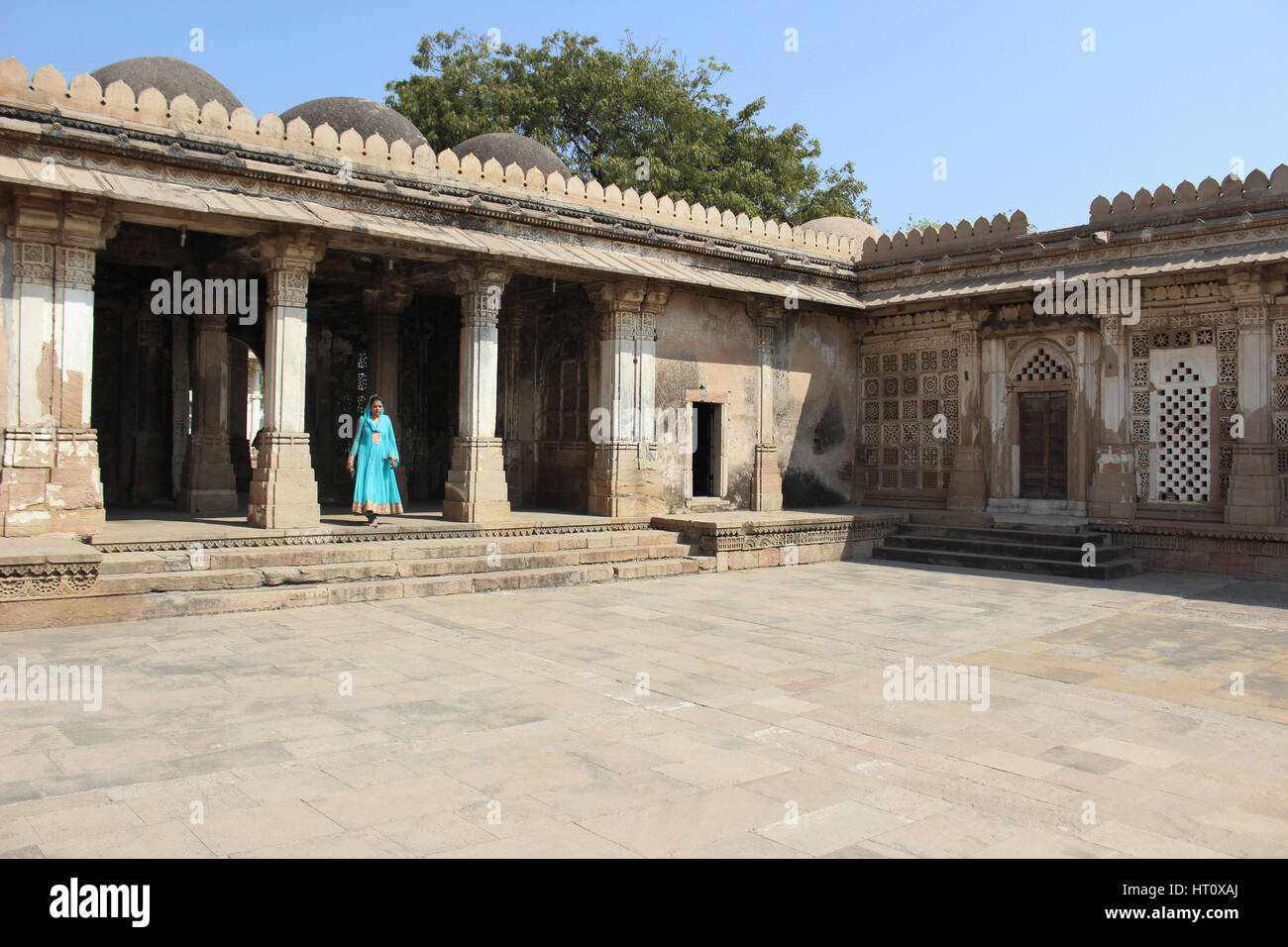 Tourist standing at courtyard at Sarkhej Roza, Makarba, Ahmedabad in Gujarat India. - Stock Image