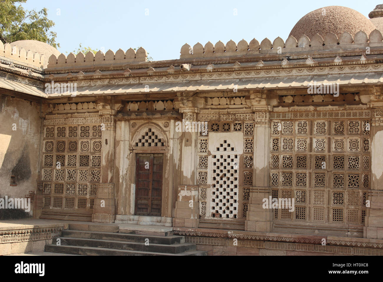 Stone work on the window grills seen from the courtyard near step tank at Sarkehj Roza, Ahmedabad, Gujarat India. - Stock Image