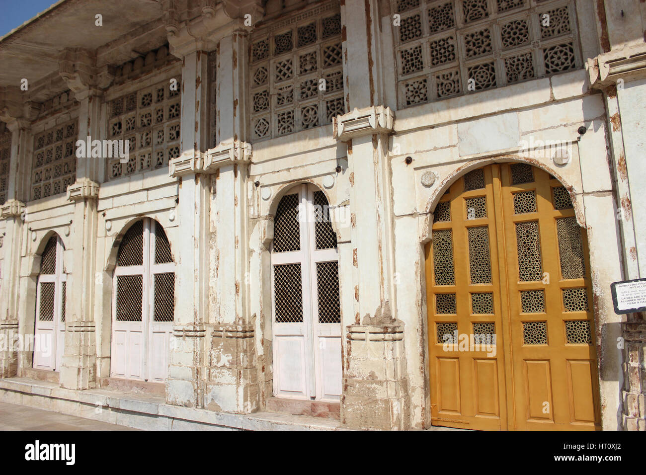 Stone jali work on the doors and walls and niches. Sarkhej Roza, Ahmedabad, Gujarat India - Stock Image