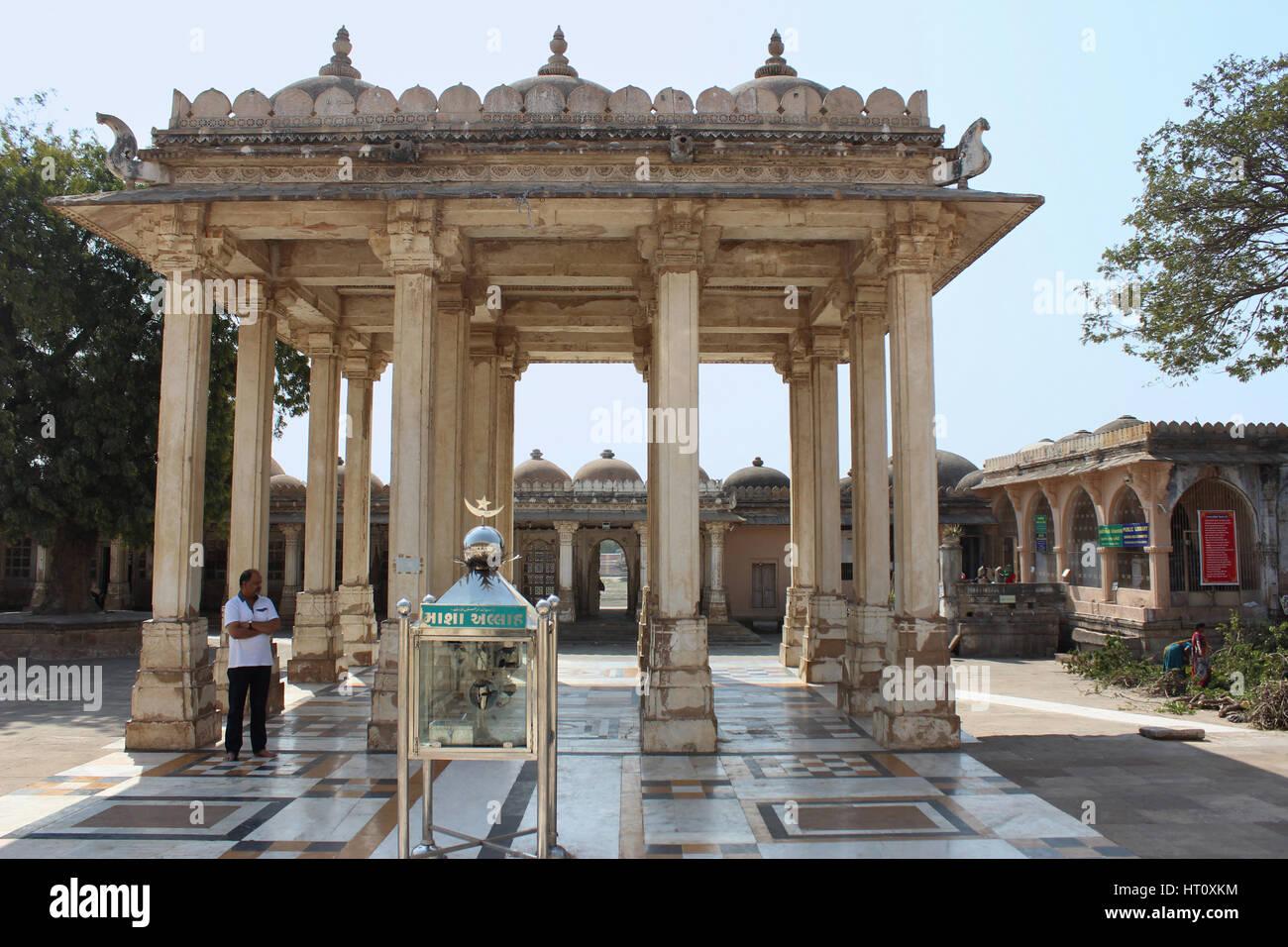 Sixteen-pillared structure known as the Baradari. Sarkhej Roza, Ahmedabad, Gujarat India. Baradari stands in front - Stock Image