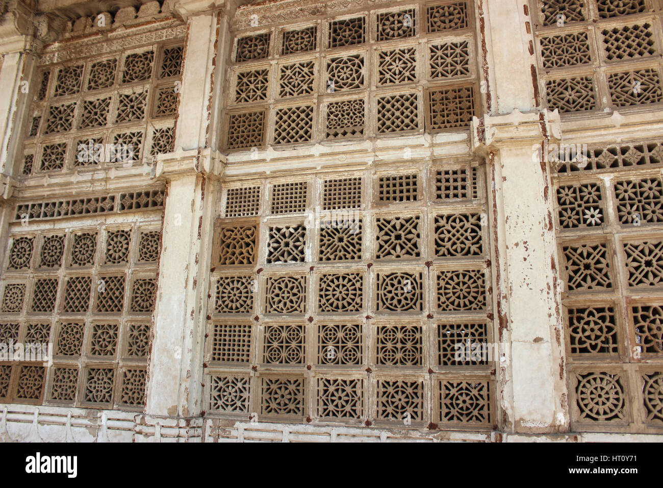 Perforated stone work at the exteriors of Sarkhej Roza, Makarba, Ahmedabad, Gujarat, India - Stock Image