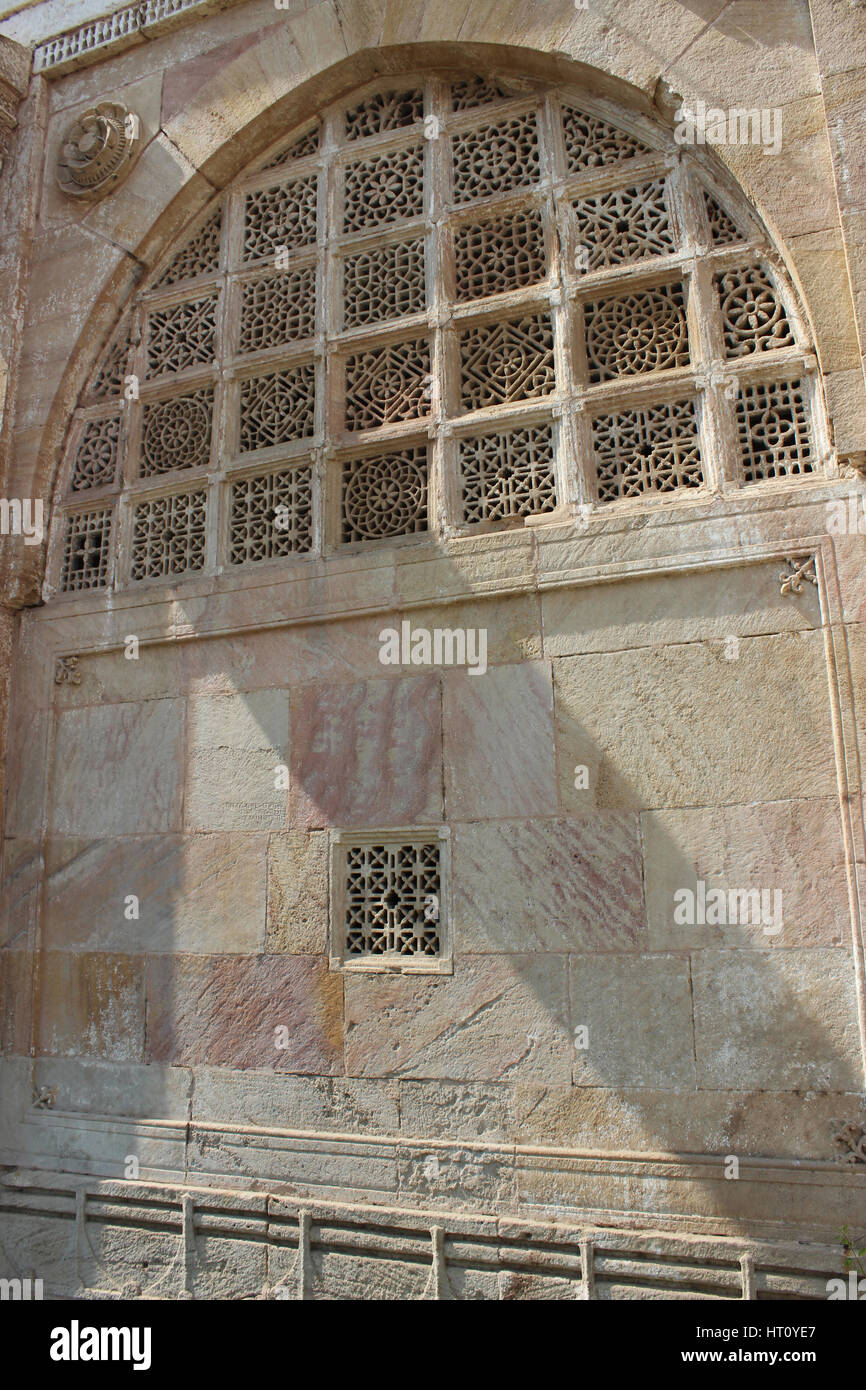 Stone ornamented meshed walls, arches entrance of Sarkehj Roza, Makarba, Ahmedabad in Gujarat India. - Stock Image