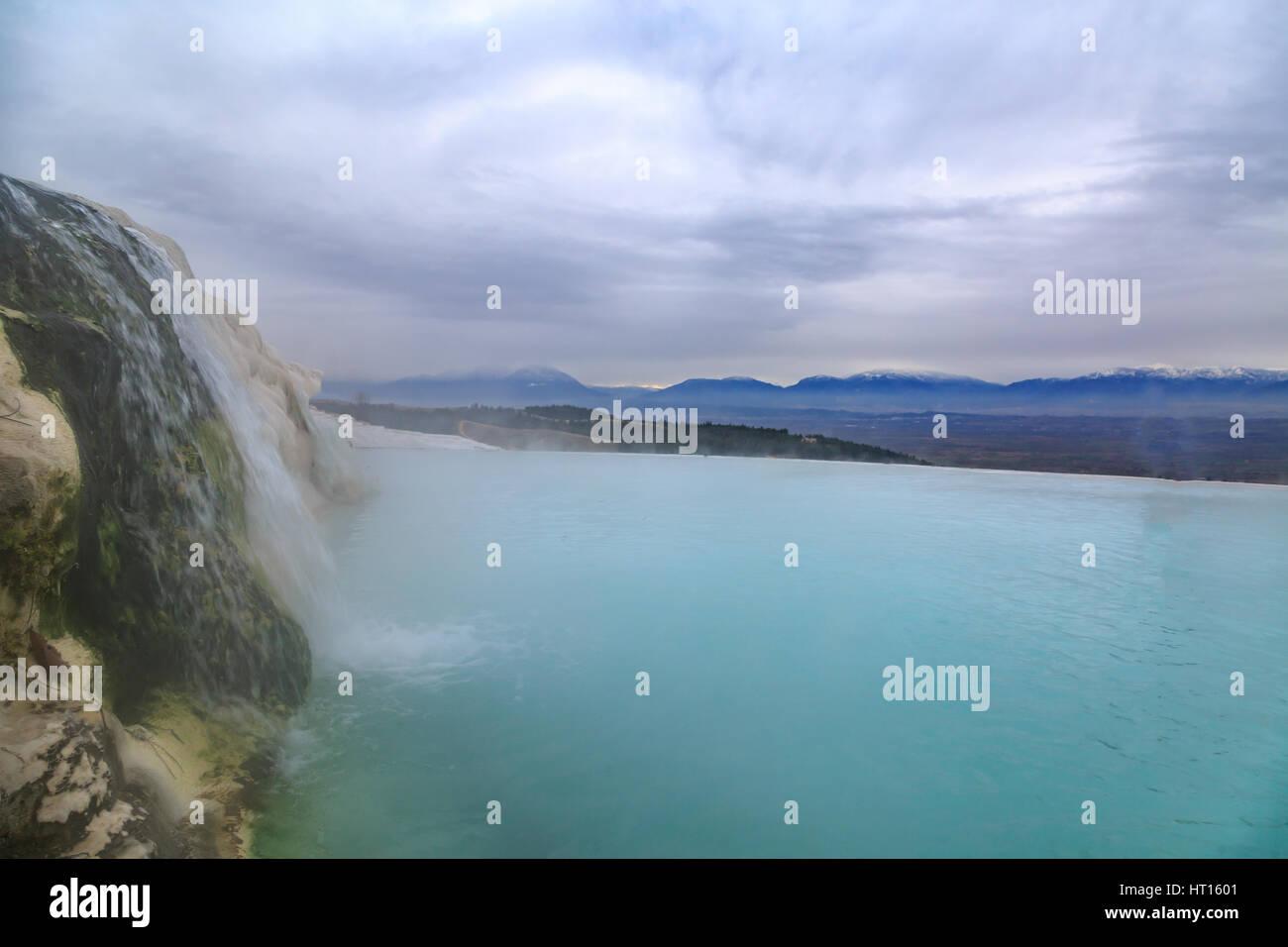 Water falling in travertine in Pamukkale in winter - Stock Image