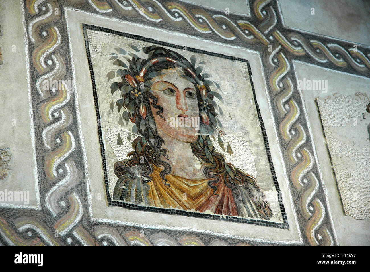 Mosaic of garlanded woman  Culture: Roman.  Period/ Date: 2nd - 3rd C AD.  Place of Origin: House of Artist: Werner - Stock Image
