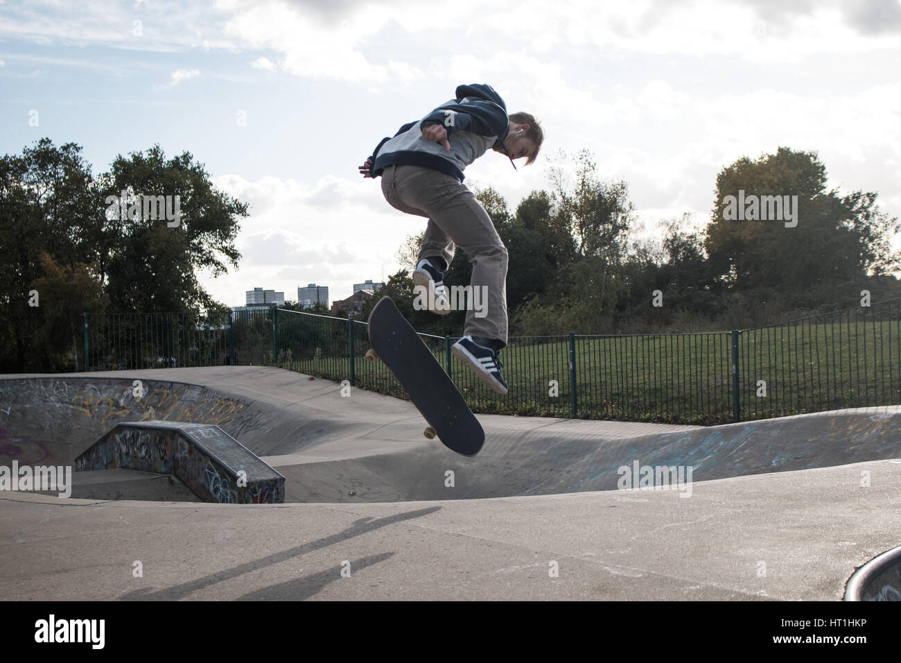skater jumping at the skate ground in London - Stock Image