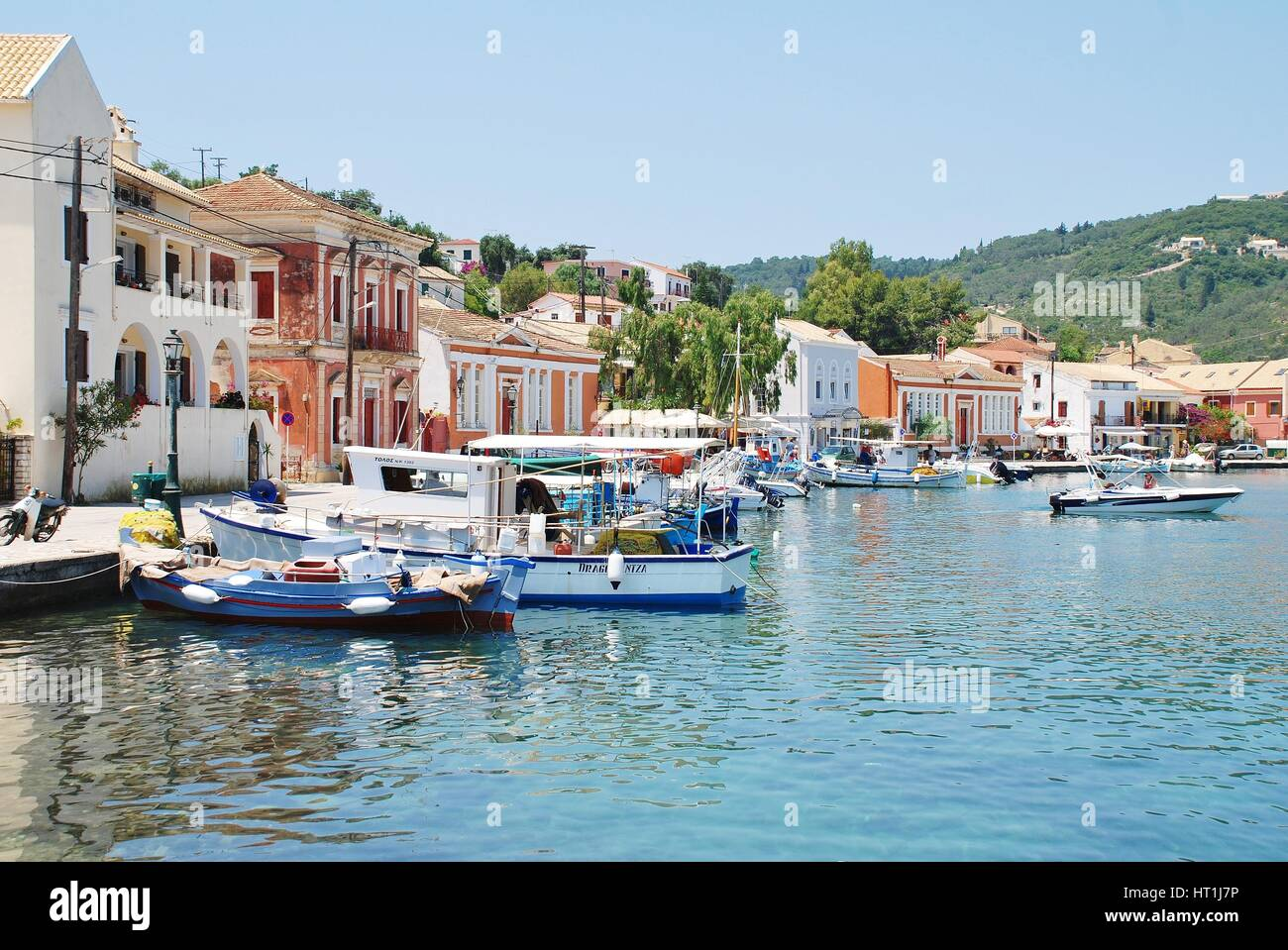 Small boats moored in the harbour at Gaios, the Capital of the Greek island of Paxos. - Stock Image
