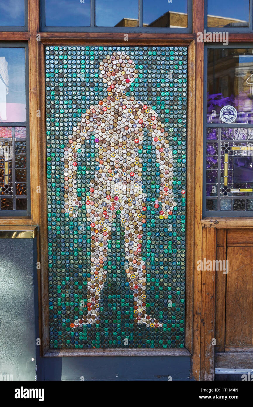 Human figure created from beer bottle tops. Bottle top art. Bottle cap art. Art and crafts design. Upcycle. Bottle - Stock Image