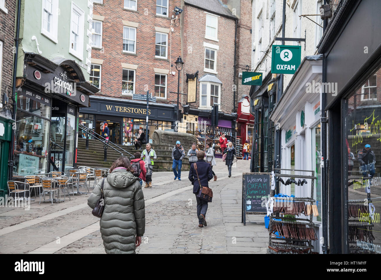 Shoppers And Tourists Walking Through Old Elvet Street In Durham