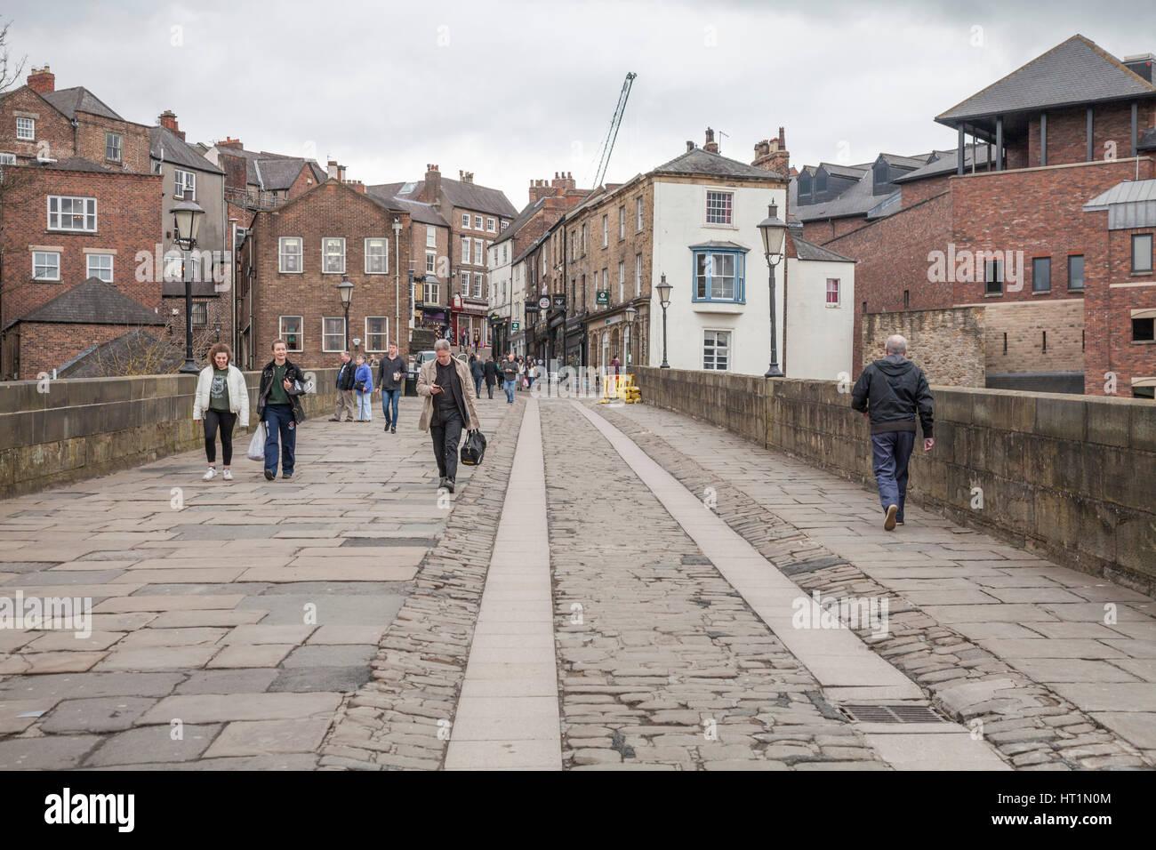 People Walking Across Old Elvet Bridge In Durham City Stock Photo