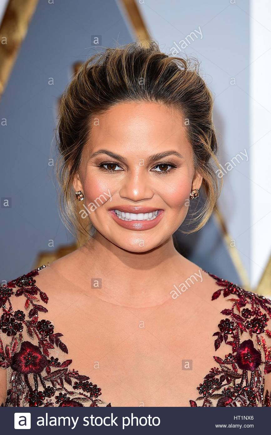 File photo dated 28/02/16 of model and TV presenter Chrissy Teigen who has revealed she has been battling with postpartum - Stock Image