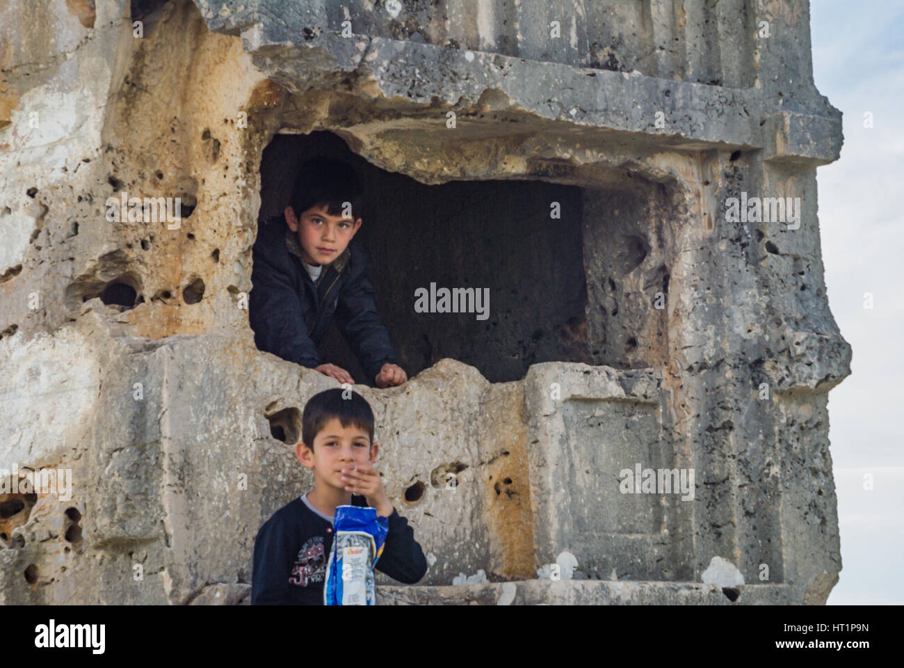 young boys playing game in historical ruins - Stock Image