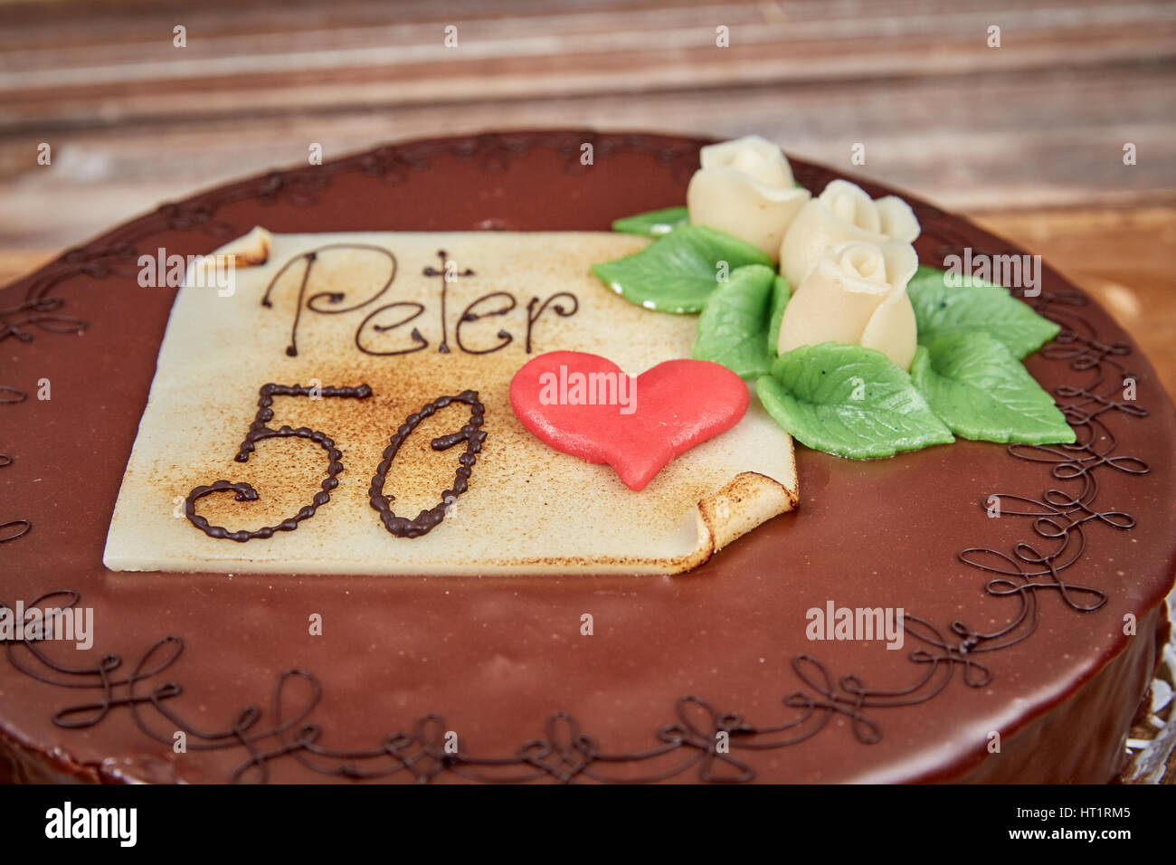 Birthday cake for Peter´s fiftieth brithday chocolate sacher torte - Stock Image