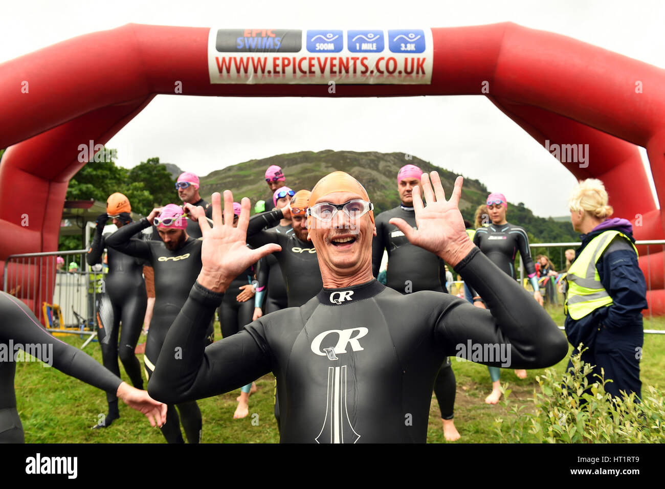 Swimmer posers for the camera before his 1 mile swim with Epic Events, Lake Ullswater, Cumbria - Stock Image