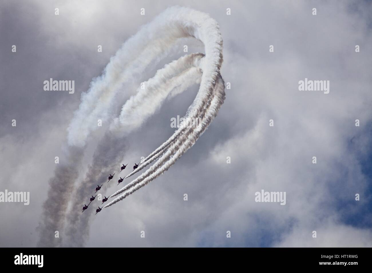 The Red Arrows RAF Royal Air Force Aerobatic Team in flight during a display at Bournemouth Air Festival 2015 - Stock Image