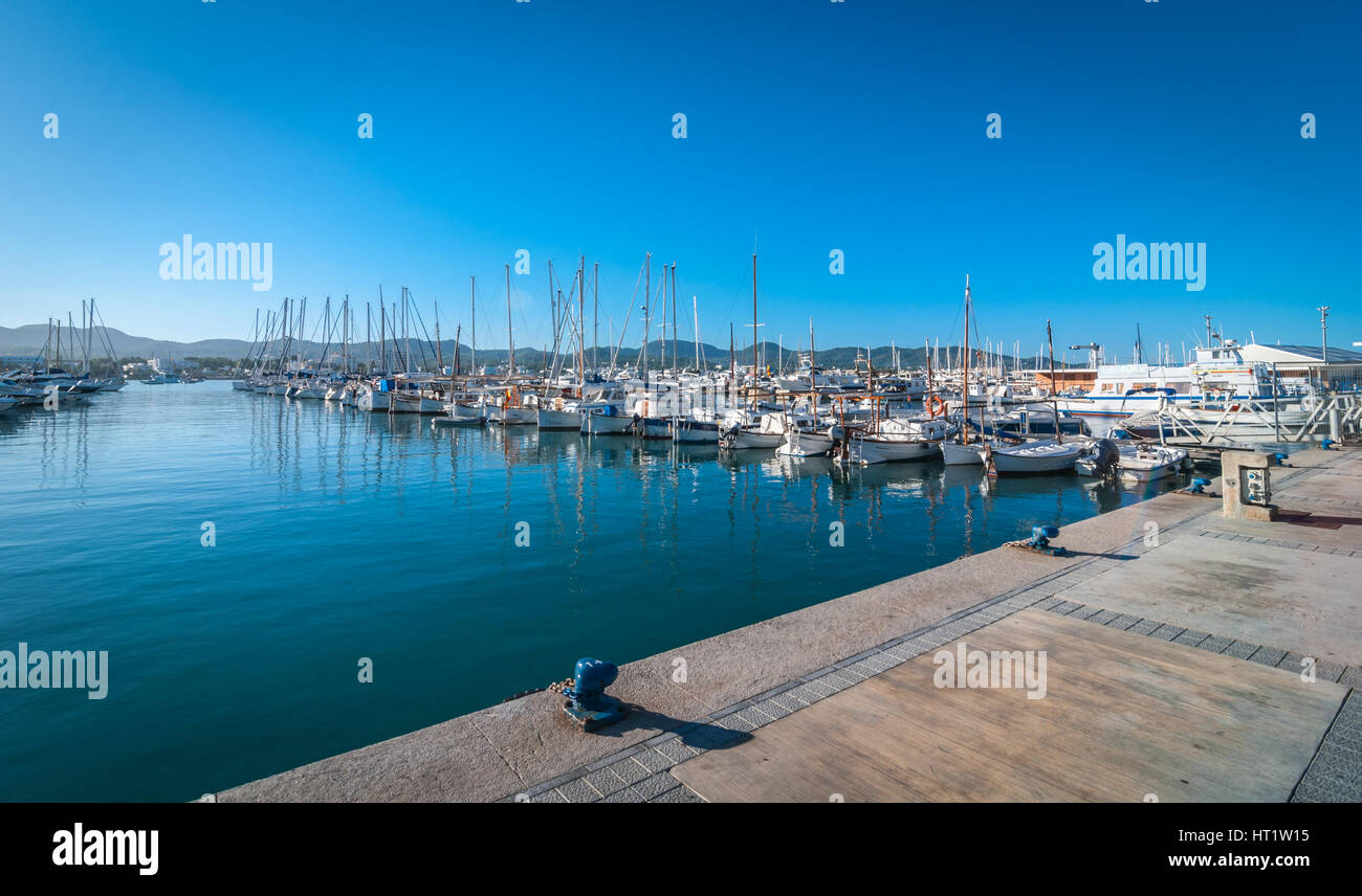 Boats, small yachts & water craft of all size in Ibiza marina harbour.  Warm sunny day. - Stock Image