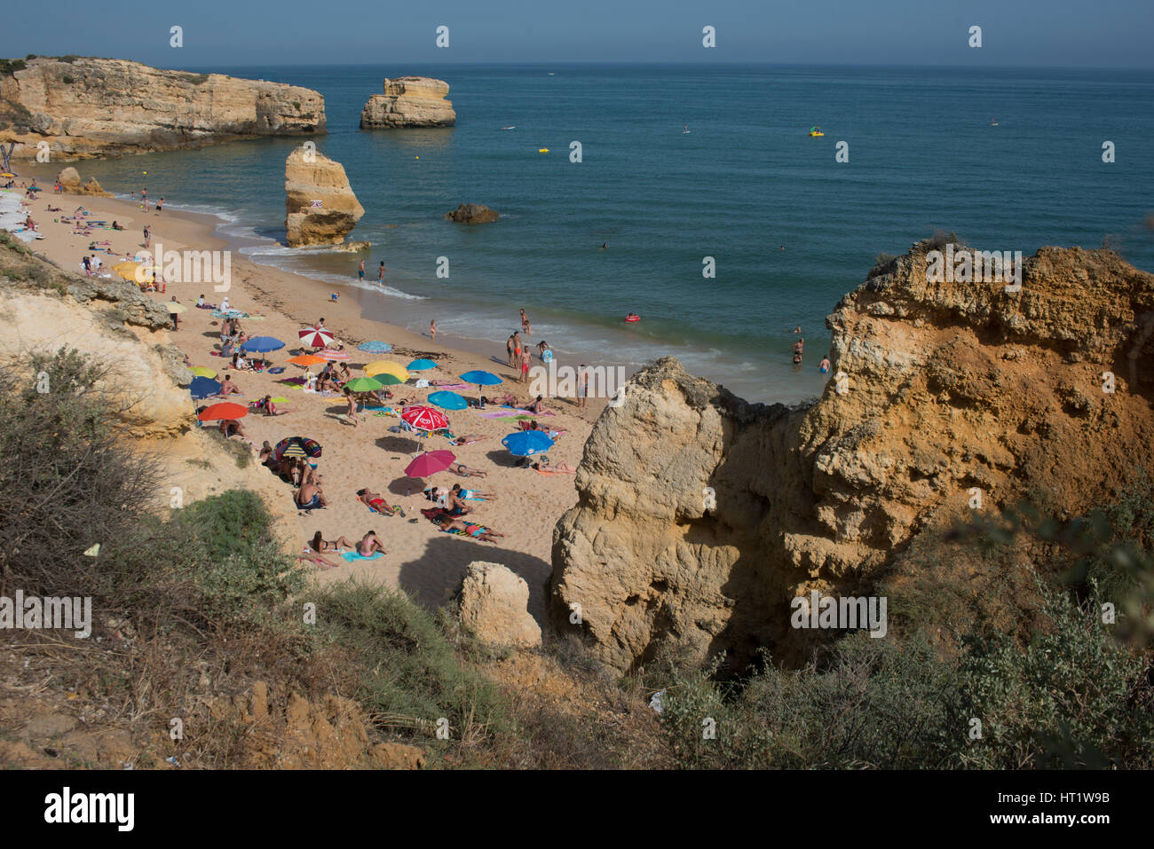 Beach with cliffs and sand on the Algarve coast, Portugal - Stock Image