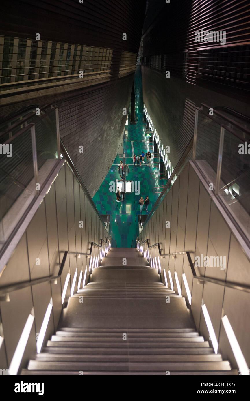 02.09.2016, Singapore, Republic of Singapore - Stairwell to the Stadium MRT Station. Stock Photo