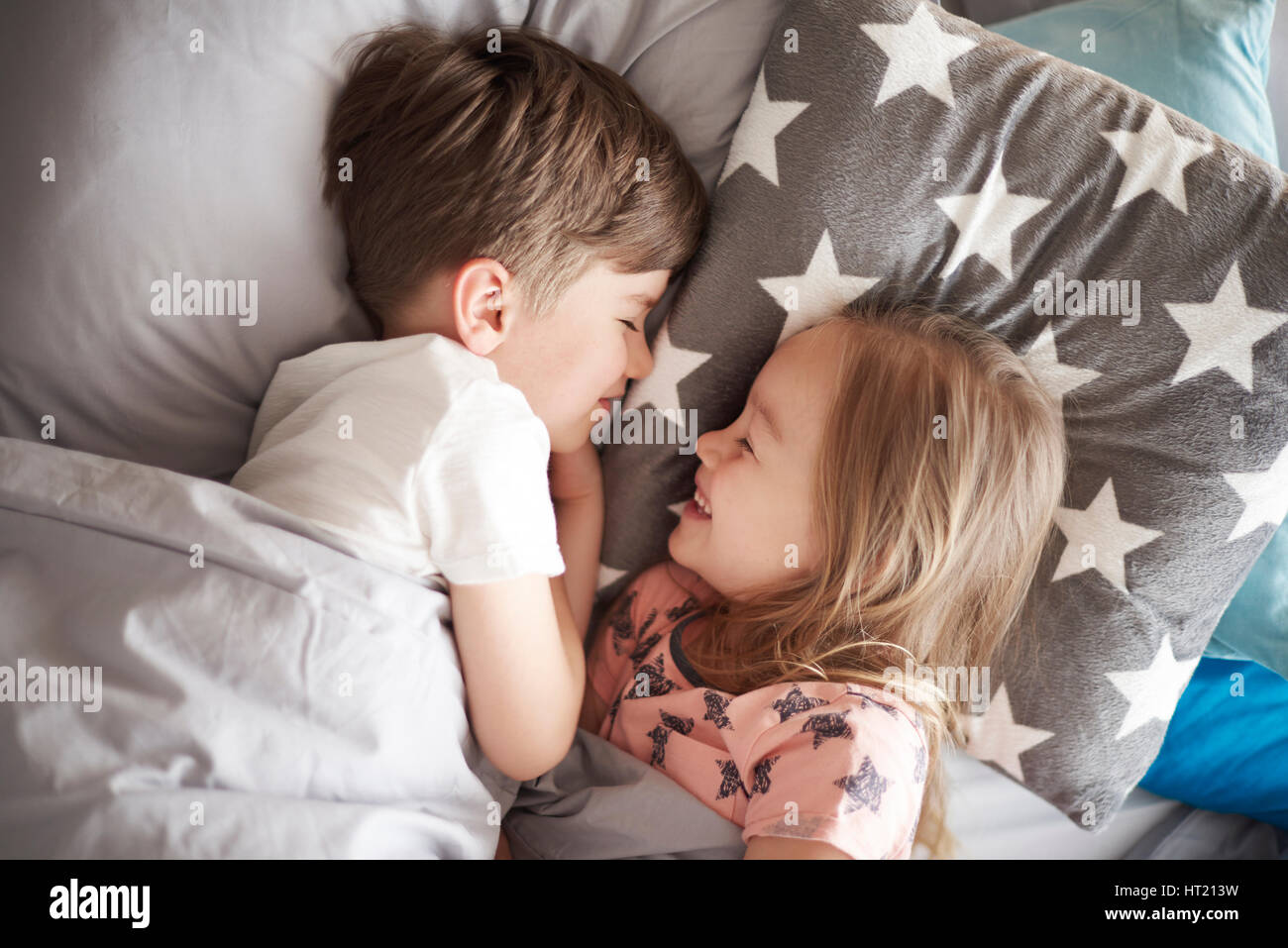 High angle view on sleeping siblings - Stock Image