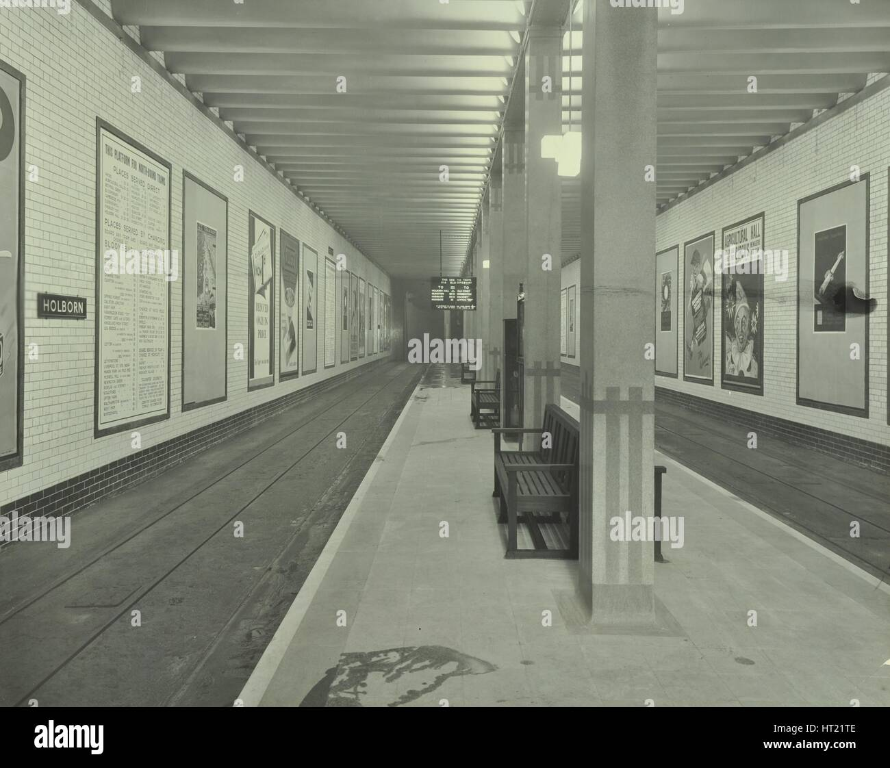 Platform with advertising posters, Holborn Underground Tram Station, London, 1931. Artist: Unknown. - Stock Image