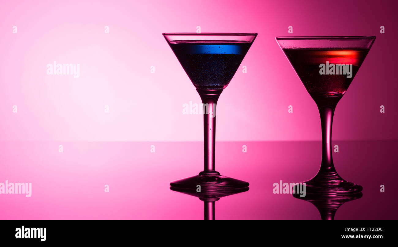 Colorful cocktails on reflective top - Stock Image