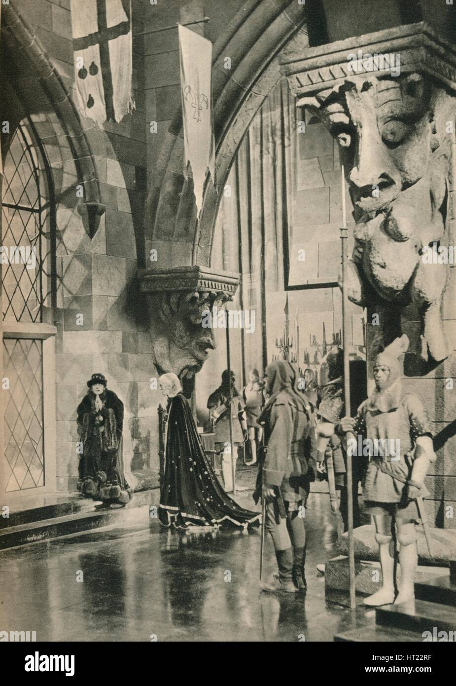 'Scene in the Palace of Louis XI. From the film: The Beloved Rogue. Settings by William Cameron Me Artist: Unknown. - Stock Image