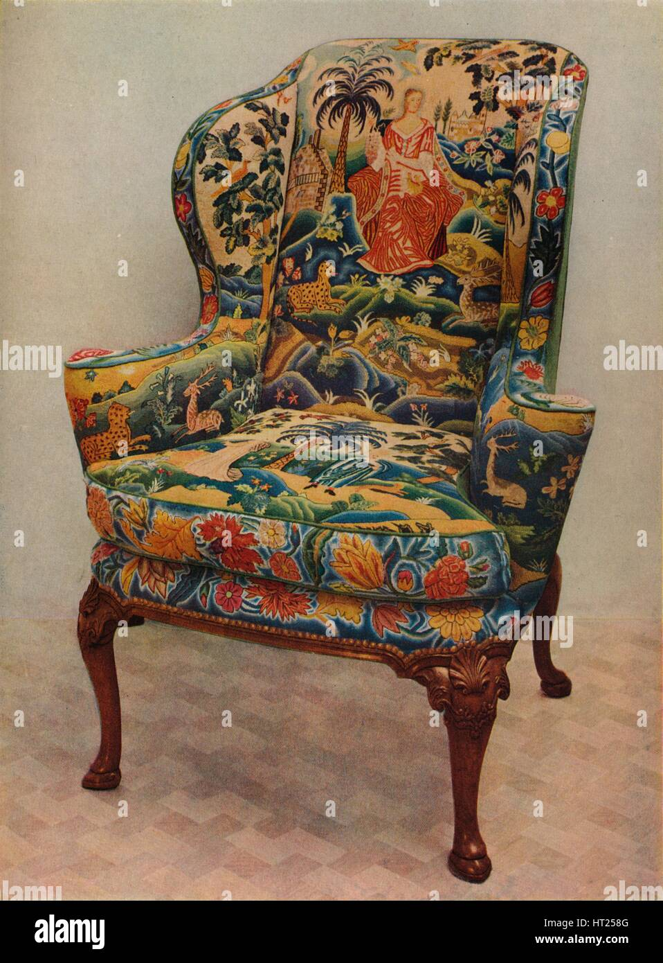 'An upholstered armchair with wings, carved walnut frame and original silk needlework covering', c17 Artist: - Stock Image