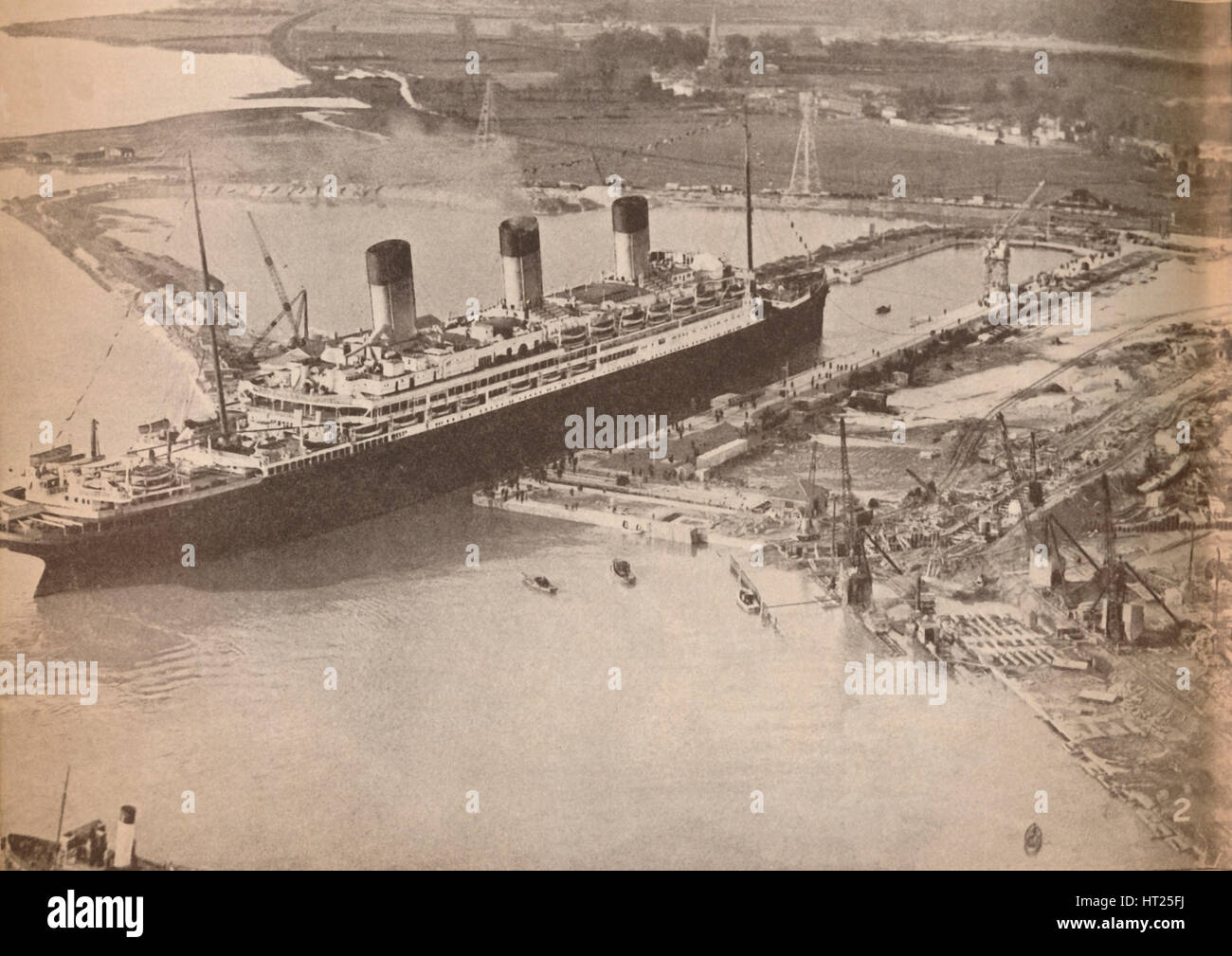 'The White Star Liner Majestic entering the world's largest graving dock at Southampton', c1934, (19 - Stock Image