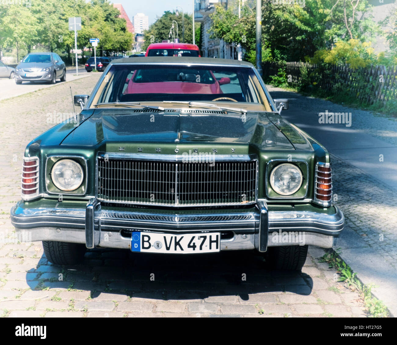 Classic green Ford Mercury Monarch automobile parked in a suburban street. Collectors vintage car. Collectible vehicle - Stock Image