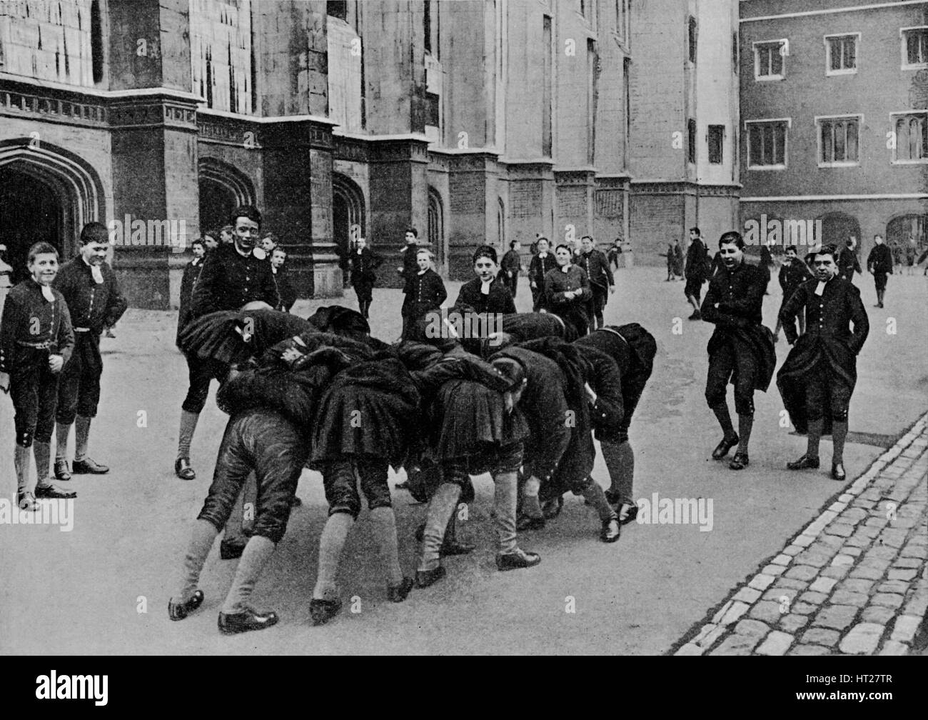An exciting game: pupils of Christ's Hospital school, City of London, c1900 (1911). Artist: RW Thomas. - Stock Image