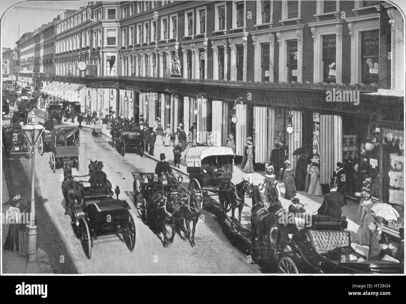 In Westbourne Grove, Notting Hill, London, c1903 (1903). Artist: Unknown. - Stock Image