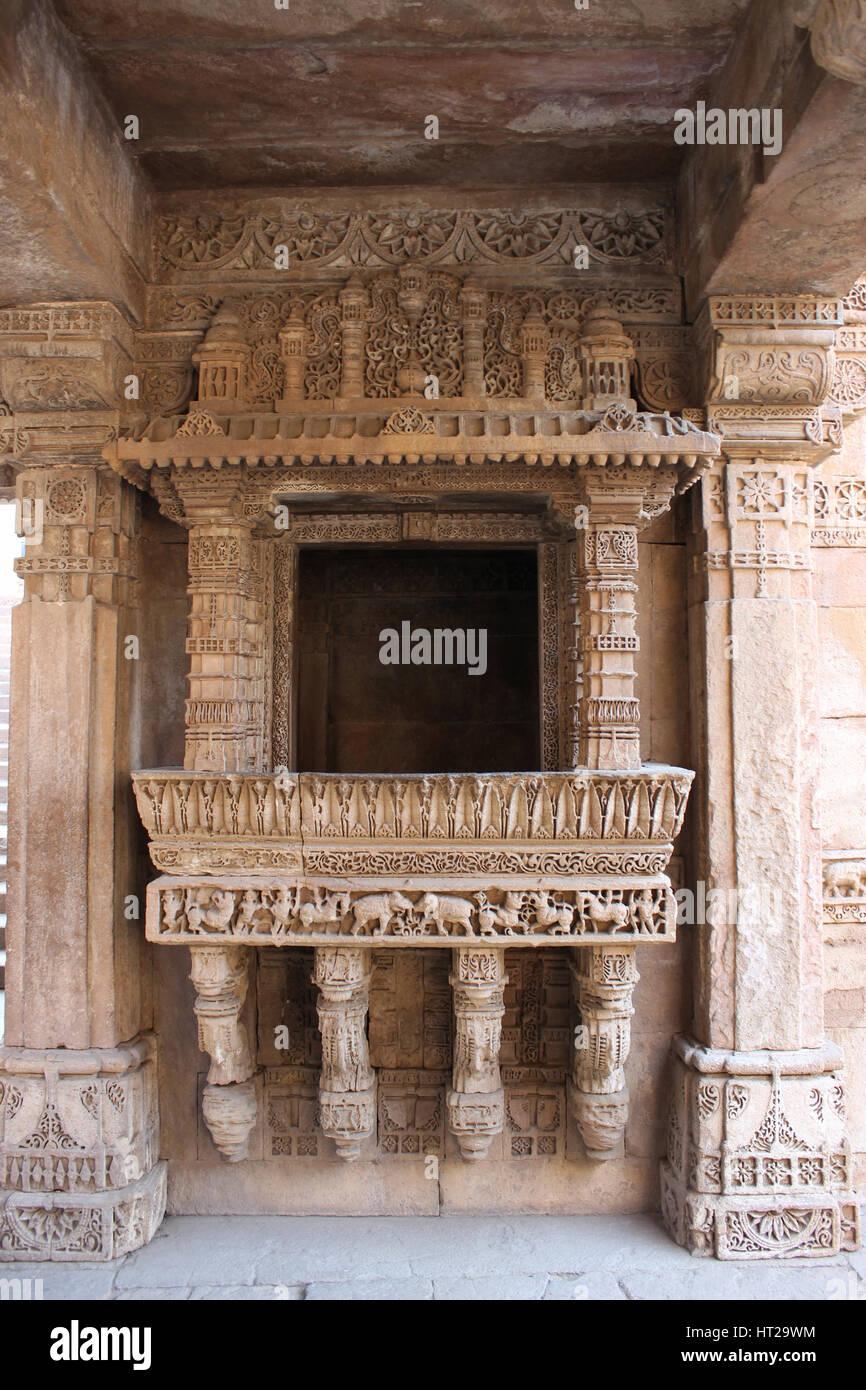 Intricate carvings and beautiful border patterns engraved on a balcony in Adalaj ni Vav, Adalaj Stepwell, Ahmedabad, - Stock Image