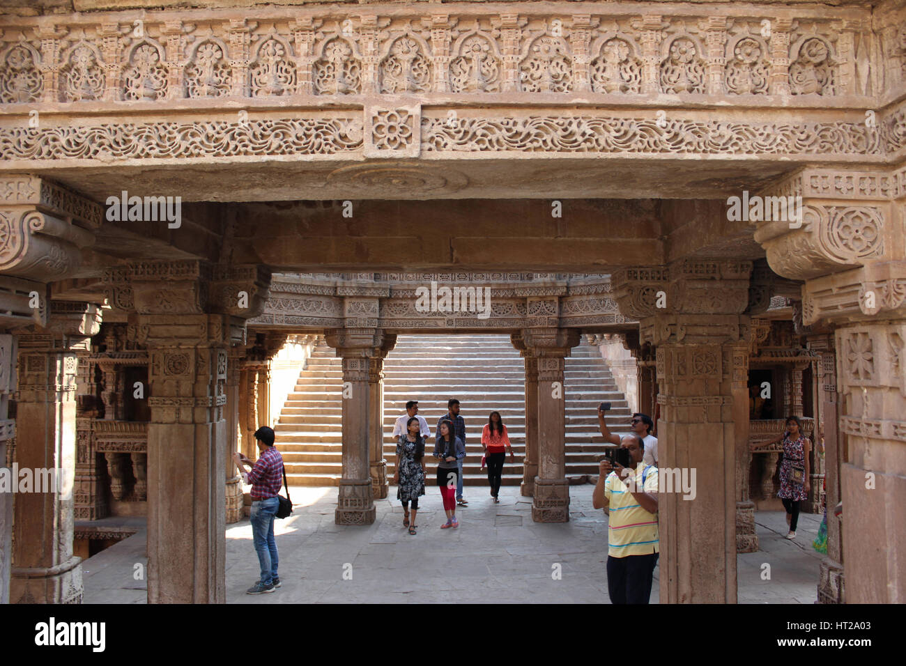 View from east inside the stepwell, decorated with intricate stone carvings in Adalaj Stepwell, Ahmedabad, Gujarat, - Stock Image