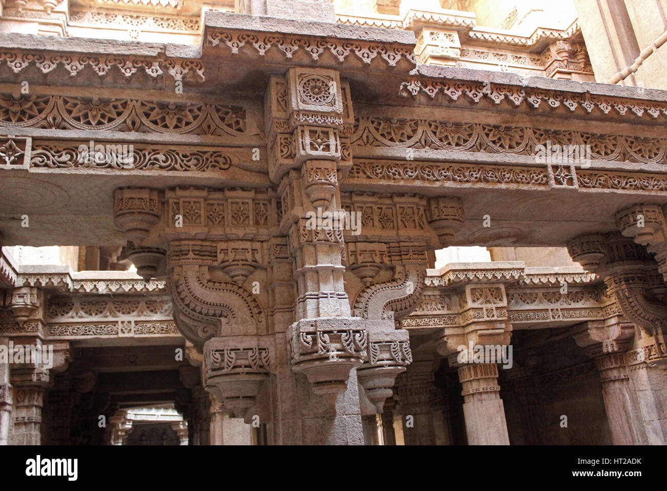 Entablature style architecture intricate carvings. Adalaj Stepwell, Ahmedabad, Gujarat, India - Stock Image