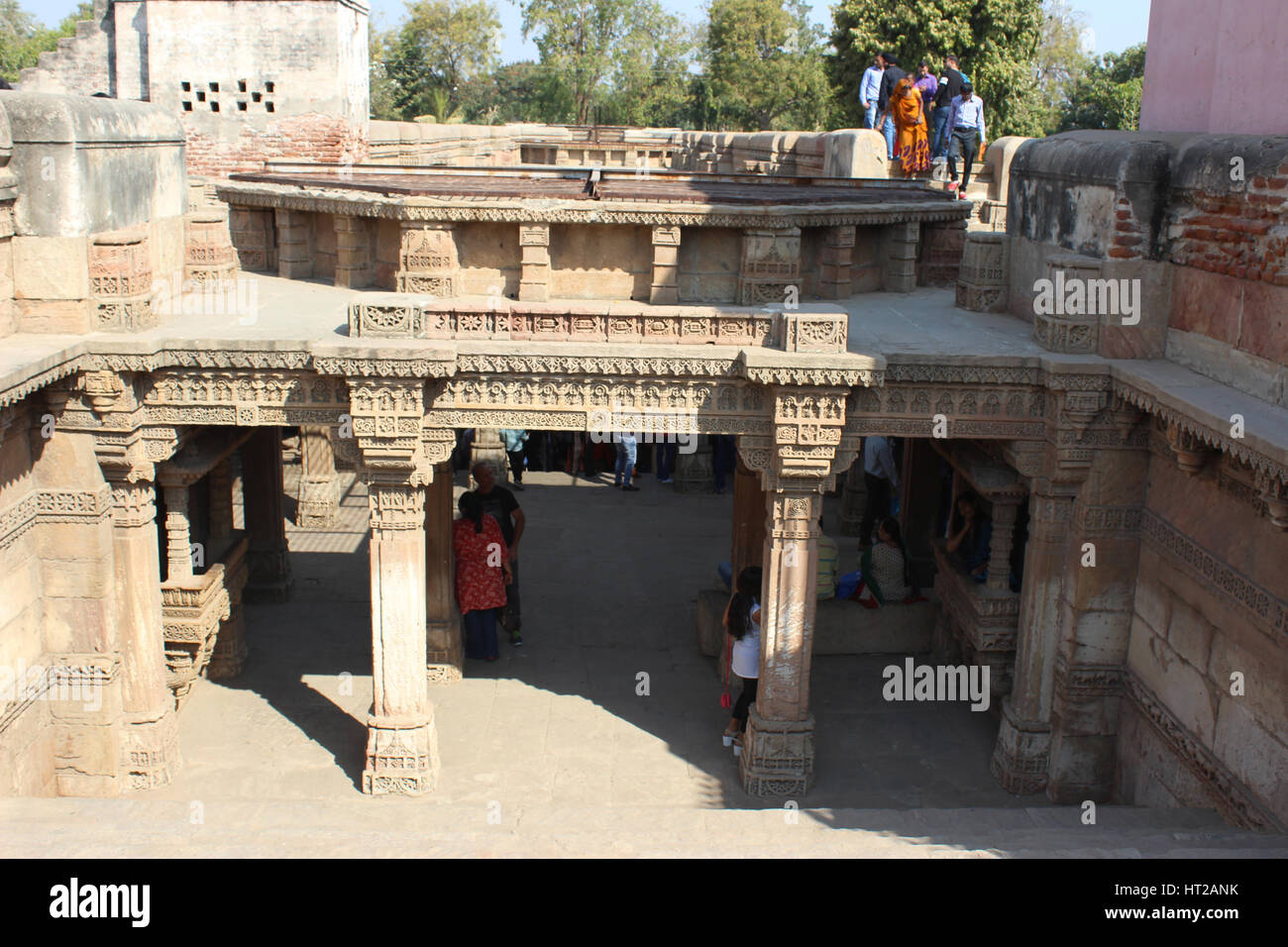 View of the Western entrance from top. Tourists at Adalaj Stepwell in Ahmedabad, Gujarat, India .The stepwell was Stock Photo