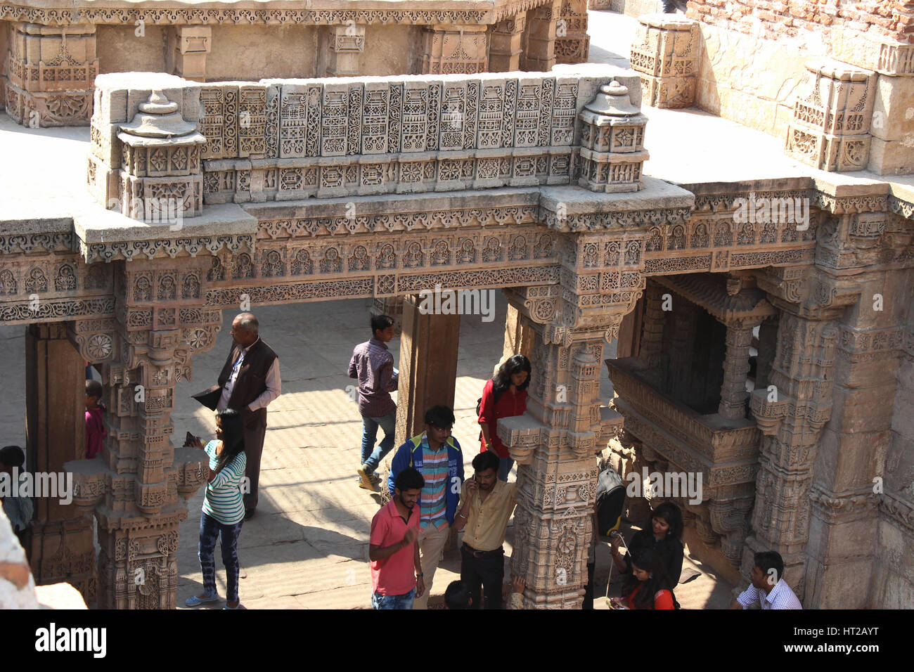 View from the top, tourist exploring the intricate carvings at Adalaj step well, Ahmedabad, Gujarat, India - Stock Image