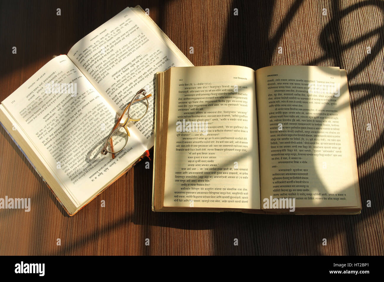 Indian holy books and glasses Stock Photo