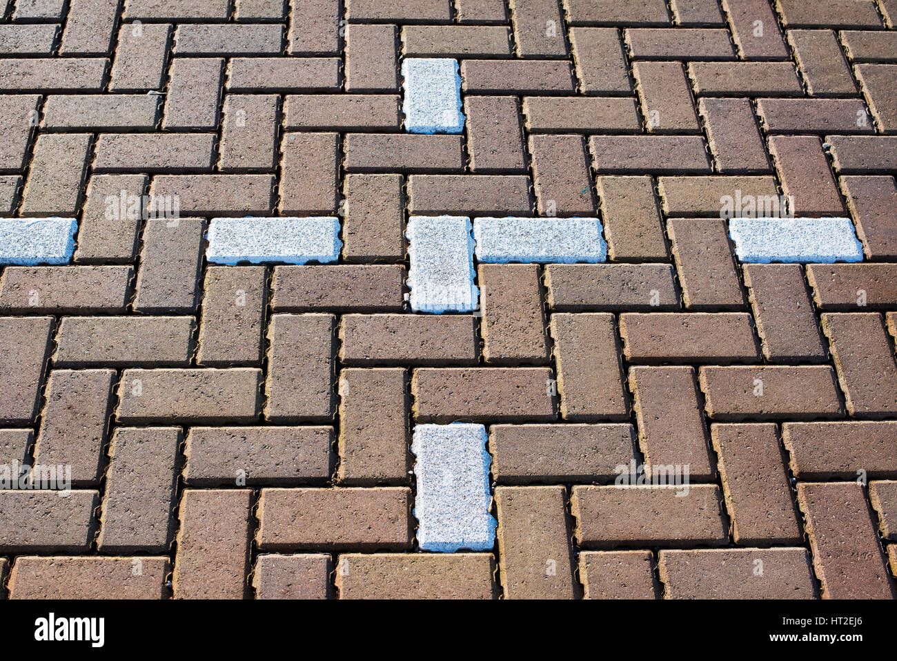 Abstract herringbone block paving in a car park pattern Stock Photo