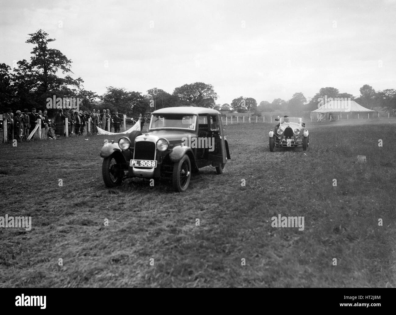 Alvis FWD and Bugatti Type 44 taking part in the Bugatti Owners Club gymkhana, 5 July 1931. Artist: Bill Brunell. - Stock Image