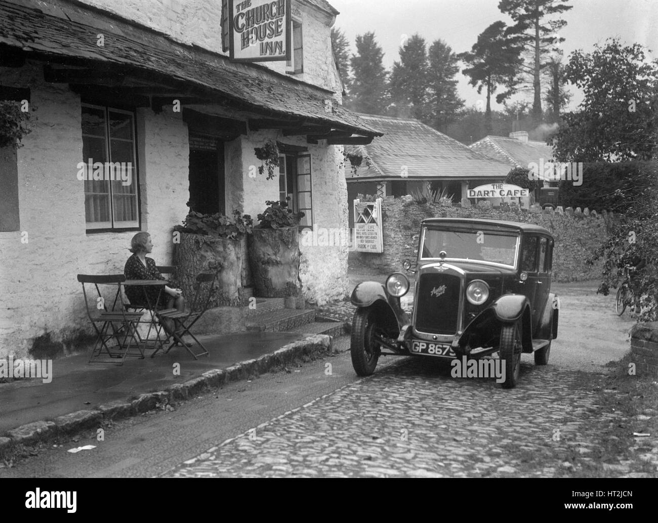 1931 Austin 16/6 on a road test, parked outside the Church House Inn, Stoke Gabriel, Devon. Artist: Bill Brunell. - Stock Image